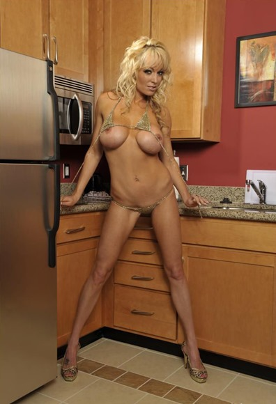 milf-mia-stripping-in-the-kitchen